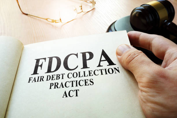 Fair Debt Collection Practices Act FDCPA on a table. stock photo