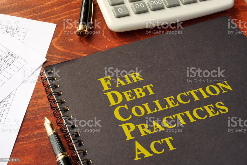 FDCPA Fair Debt Collection Practices Act on a table. stock photo