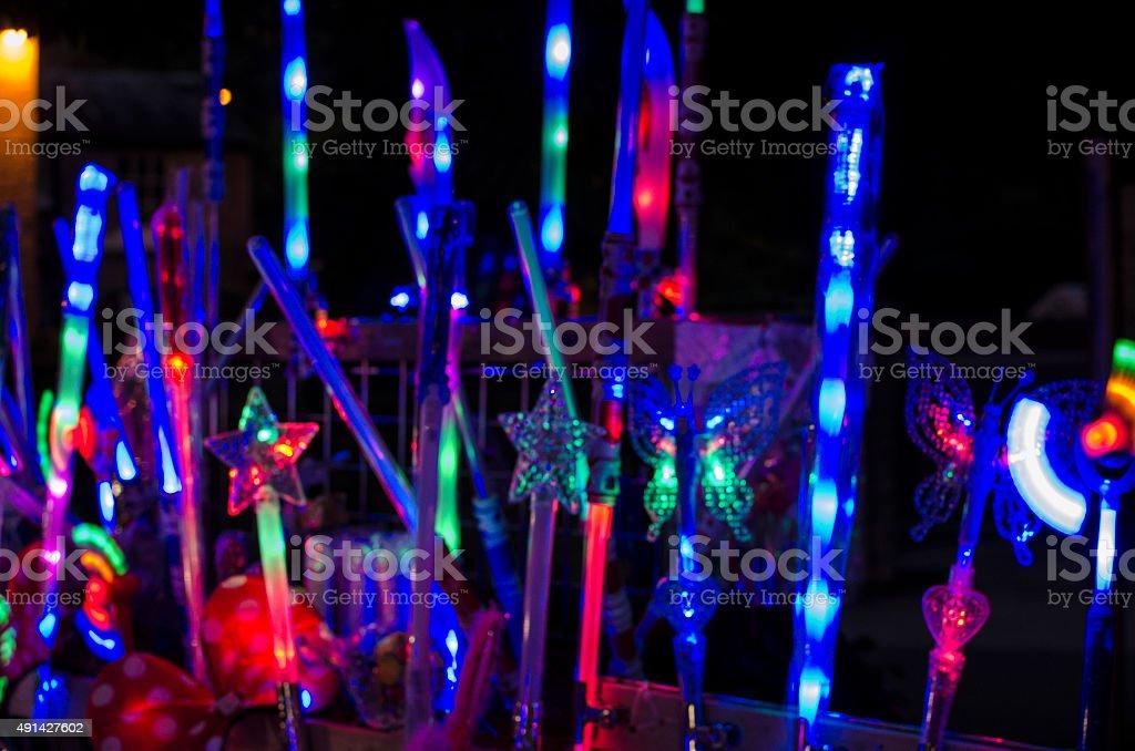 Fair ground toys at night illuminations stock photo