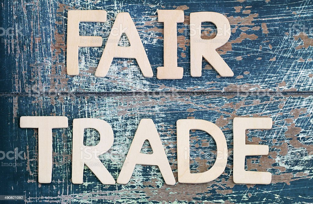 Fair trade written on rustic wooden surface stock photo