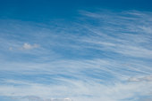 Stock photo of clouds in fair weather sky, even with diffuse edges, for background inserts.
