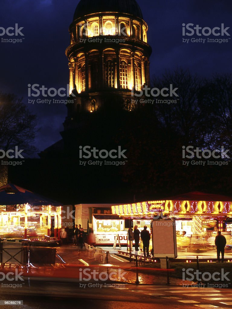 Fairground at Night by Cathedral. Boulogne. France royalty-free stock photo