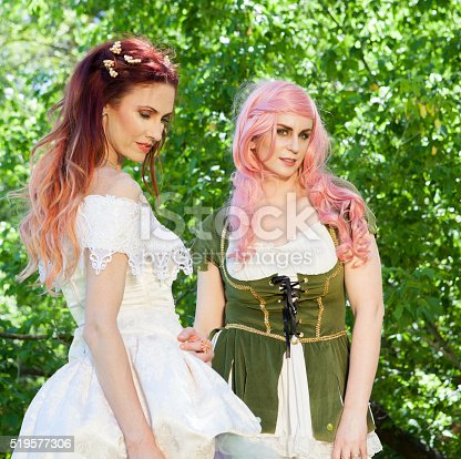 Women posing in the forest dressed as fairies - Stock Image - Salt Lake City area of Utah
