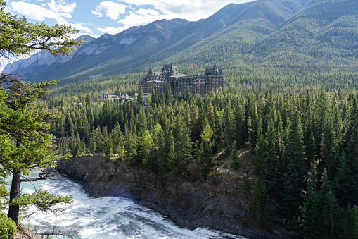 Fairmont Banff Springs in summer sunny day. View from Surprise Corner Viewpoint. Banff National Park, Canadian Rockies. Alberta, Canada.
