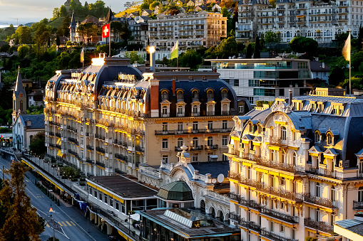 Fairmont Le Montreux Palace Hotel in the evening. The famous five-star luxury hotel was built in 1906 and offers a luxurious stay for visitors to the Swiss Riviera in Montreux.