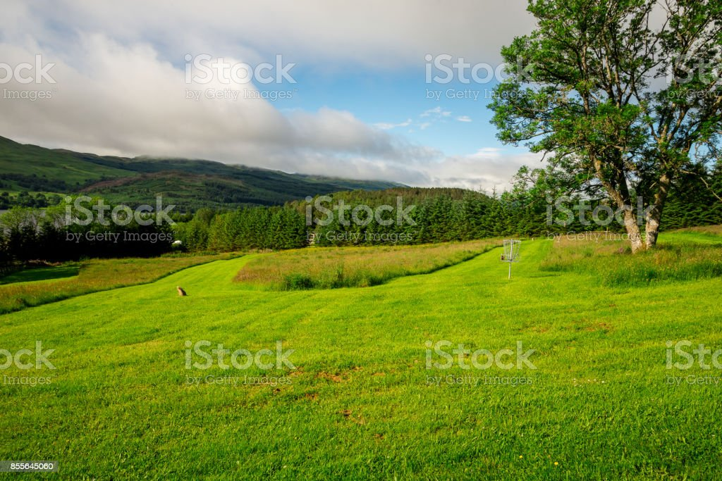 Fairway lawns at Loch Tay Highland Lodges disc golf course, central Scotland stock photo