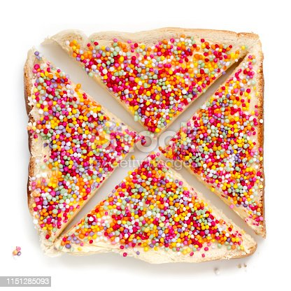 Fairy bread, top view, isolated on white.  Australian children's party food, with colourful sprinkles.