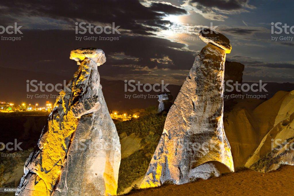 Fairy Chimneys at night with the moon in the sky, Cappadocia, Turkey stock photo