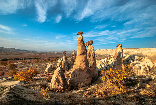 Fairy Chimneys in Cappadocia A landscape in Cappadocia at autumn. There are fairy chimneys. anatolia stock pictures, royalty-free photos & images