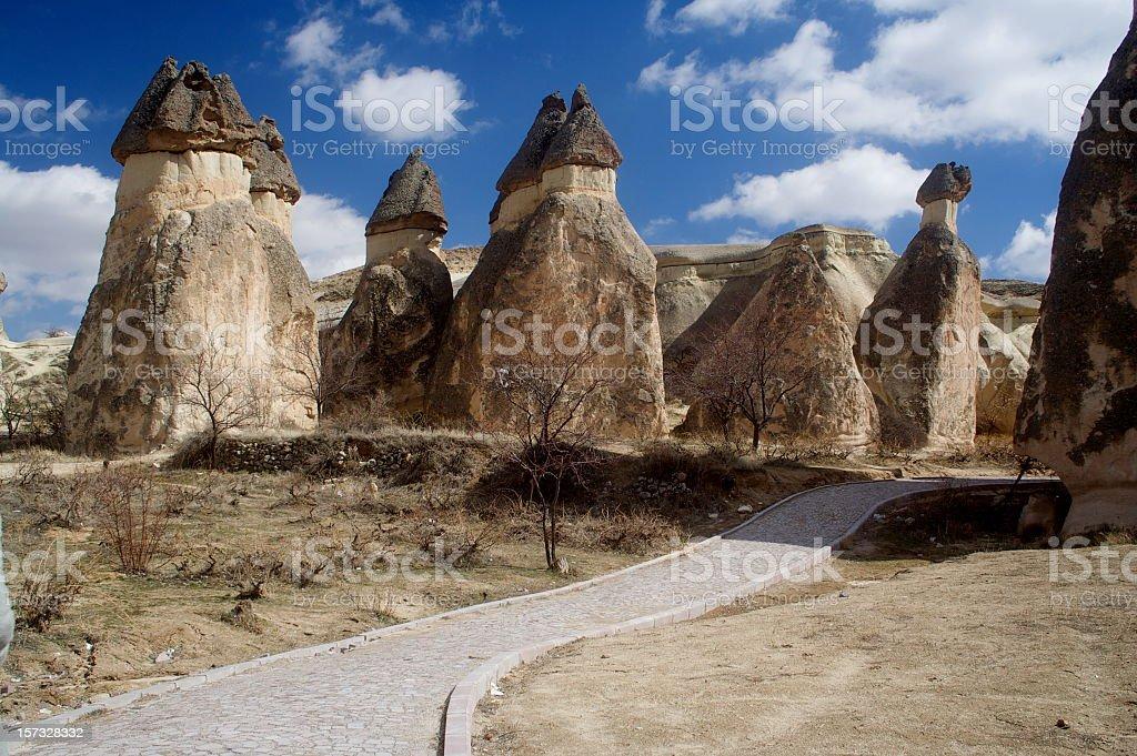 Fairy chimneys in Cappadocia with a road stock photo
