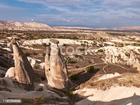A mushroom rocks, also called rock pedestals, or Fairy chimneys at the valley near Urgup, Cappadocia, Turkey. Rock Sites of Cappadocia. UNESCO World Heritage Site