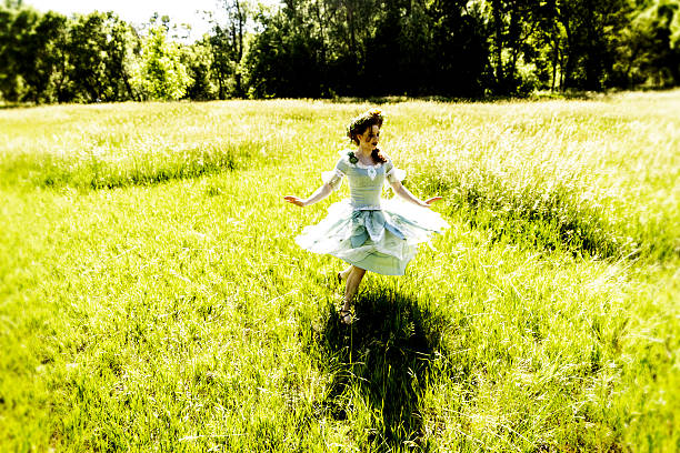 fairy dancing in field - ruler stock photos and pictures