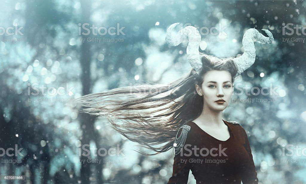 fairy demon with horns stock photo