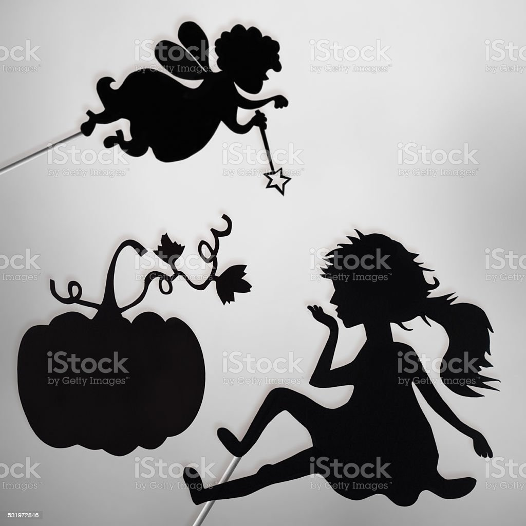 Fairy Godmother, Cinderella and Pumpkin shadow puppets, black and white stock photo