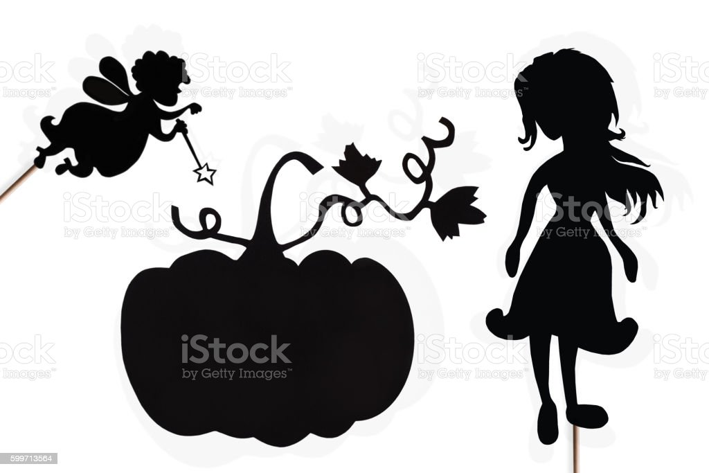 Fairy Godmother, Cinderella and Pumpkin shadow puppets on white stock photo