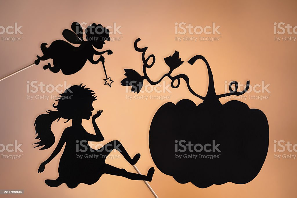 Fairy Godmother, Cinderella and Pumpkin shadow puppets stock photo
