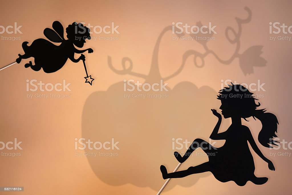 Fairy Godmother, Cinderella and Pumpkin shadow theater stock photo