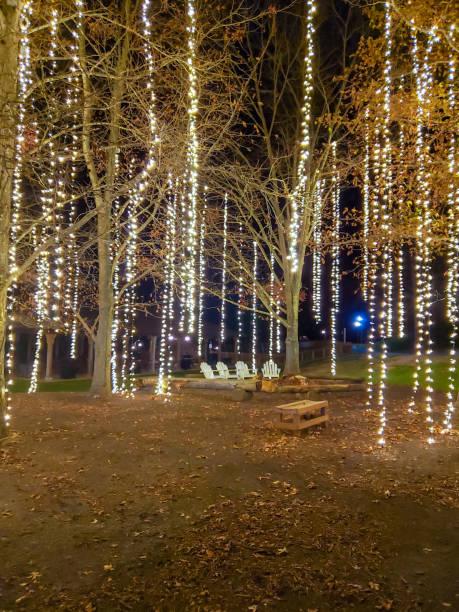 Fairy lights and Adirondack chairs stock photo