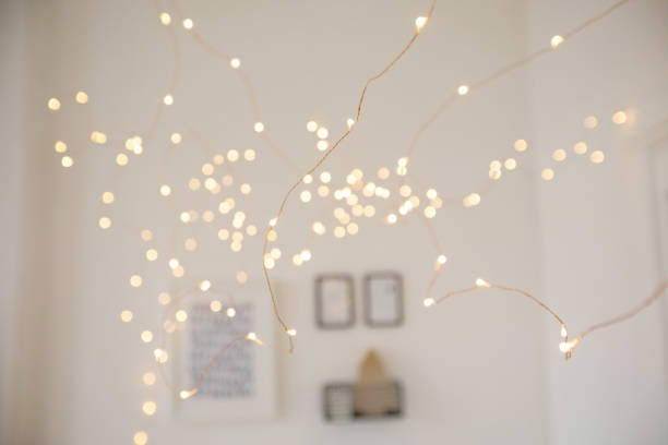Fairy lights in stylish room stock photo