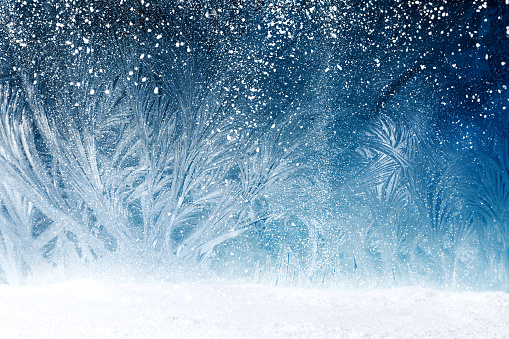 Design of fairy tale forest with snowfall on window frost