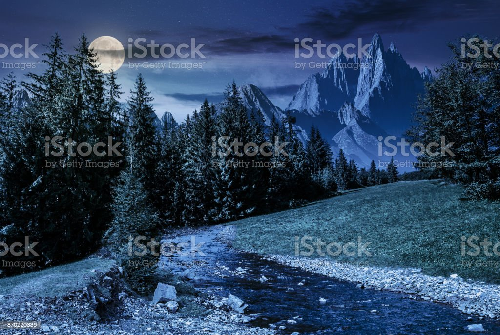 fairy tale mountainous summer landscape at night stock photo