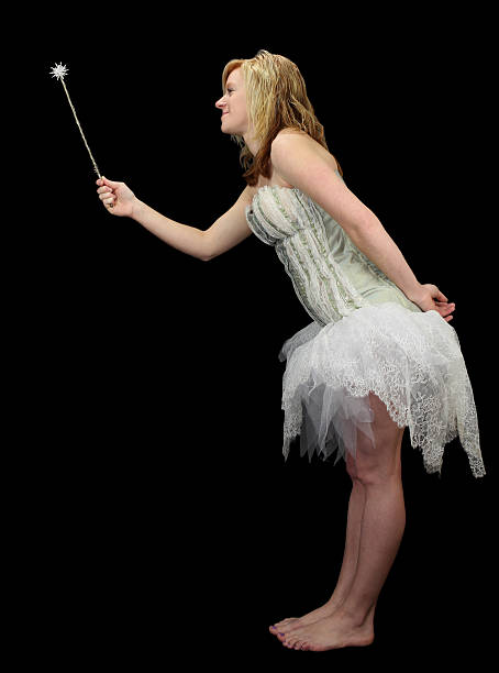 fairy with wand isolated standing in profile - fairy wand stock photos and pictures