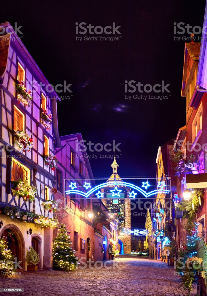 fairytale Christmas street Rue du General de Gaulle of beautiful medieval village Riquewihr, Alsace, France stock photo