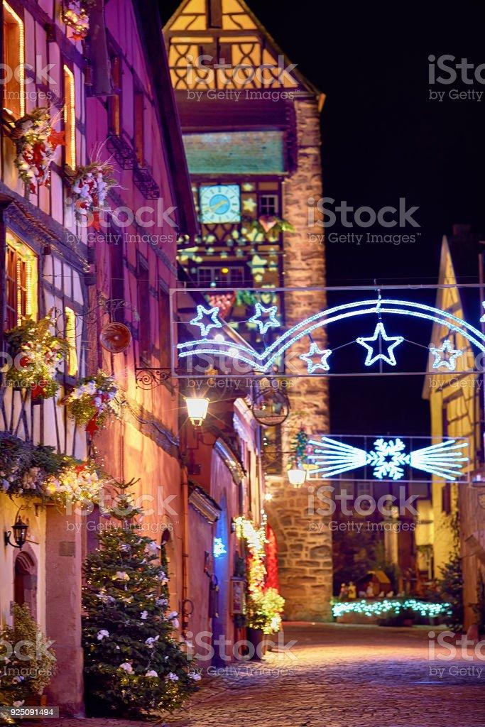 fairytale christmas street Rue du General de Gaulle of beautiful medival village Riquewihr, Alsace, France stock photo