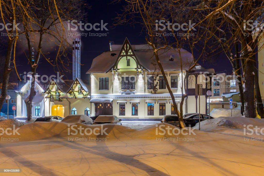 Fairy-tale house on a winter night stock photo