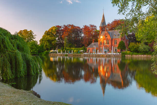 Fairytale night landscape at Lake Minnewater in Bruges, Belgium stock photo