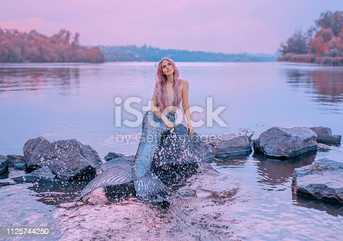 fairytale sea queen with pink long hair, jellyfish sitting on stones, dreamily looks at purple sky, mermaid splashes, sprinkles water with long, scaly tail, pastel colors, daughter of lord of oceans.