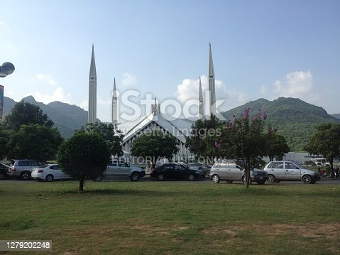 Faisal Masjid is a religious and tourist place located in Islamabad, the capital of Pakistan. This famous and beautiful architect was built as a gift from the Saudi King called Shah Faisal. This is also known as Shah Faisal Masjid.  It consists of a unique style with four erected minarets at each corner of the building.