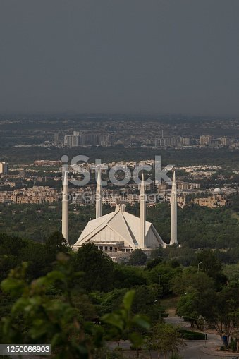Raw and can be easily edited.This is beautiful photograph of Faisal Mosque Islamabad.A religious place where thousands of people gather for prayer.This picture was taken from Margalla Hills Islamabad .