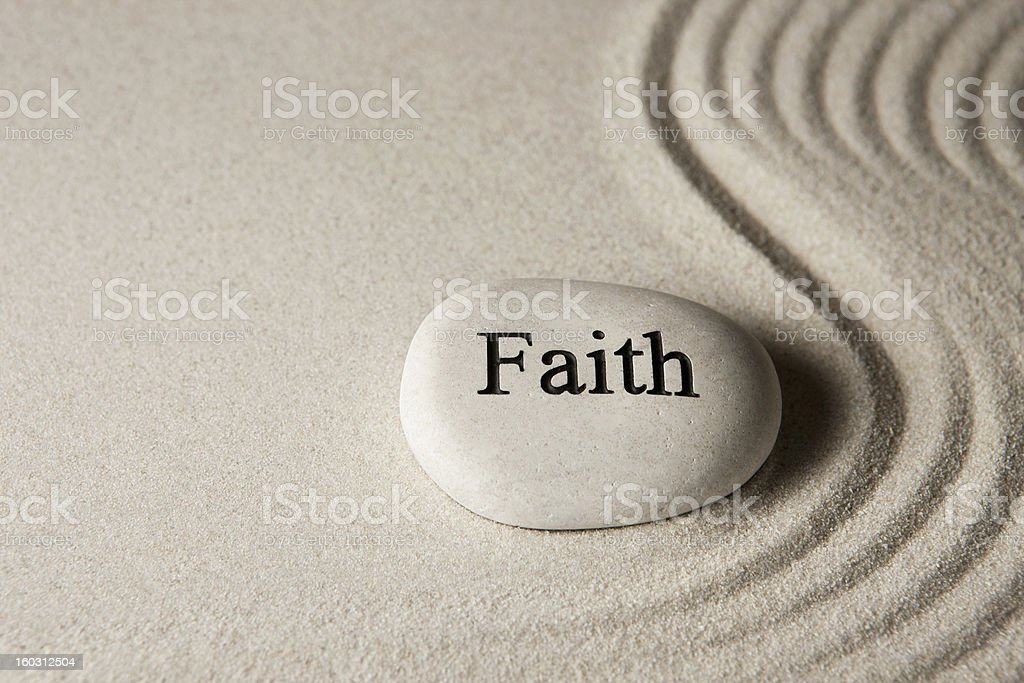 Faith stone stock photo