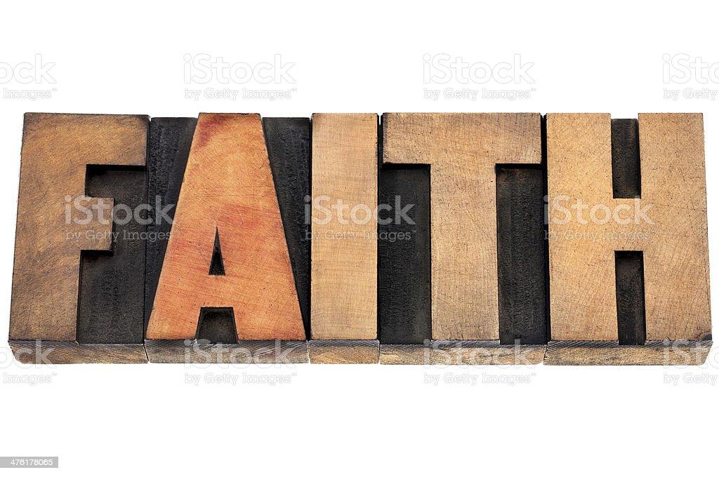 faith word in wood type stock photo