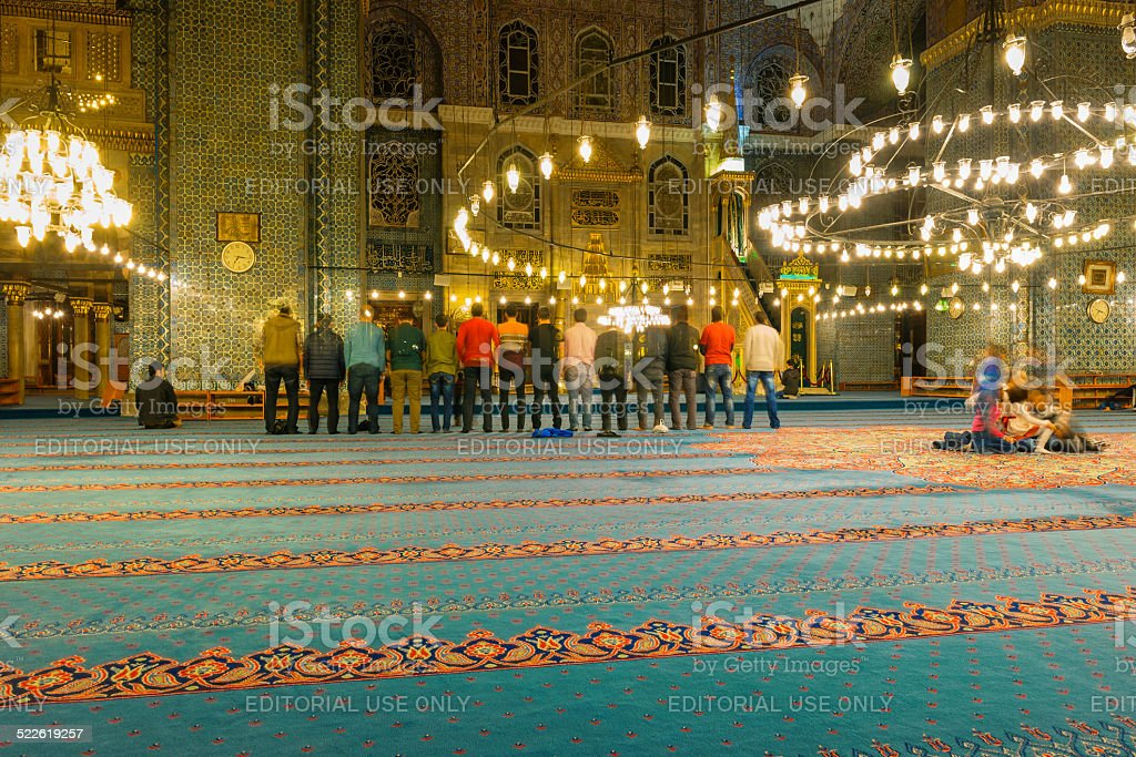 Faithful Muslims in Prayer,  Yeni Cami Mosque,Turkish Chandelier Arabesque stock photo
