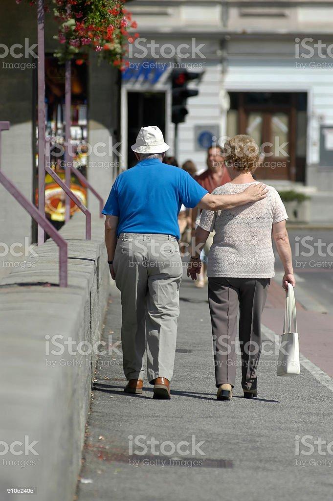 Faithfulness for ever, Elderly couple walking royalty-free stock photo