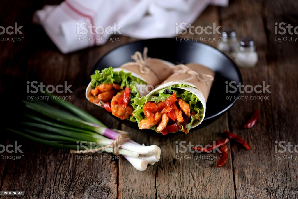 Fajitas with chicken, pepper, onion in a spicy tomato sauce, served in a tortilla. royalty-free stock photo