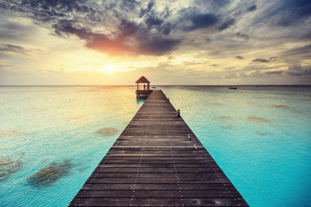 fakarava sunset at jetty french polynesia - pacific islands stock pictures, royalty-free photos & images