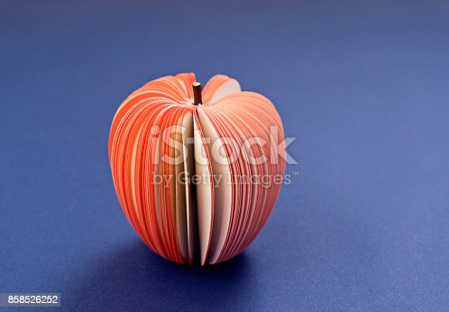 istock Fake Apple from paper on the purple background 858526252