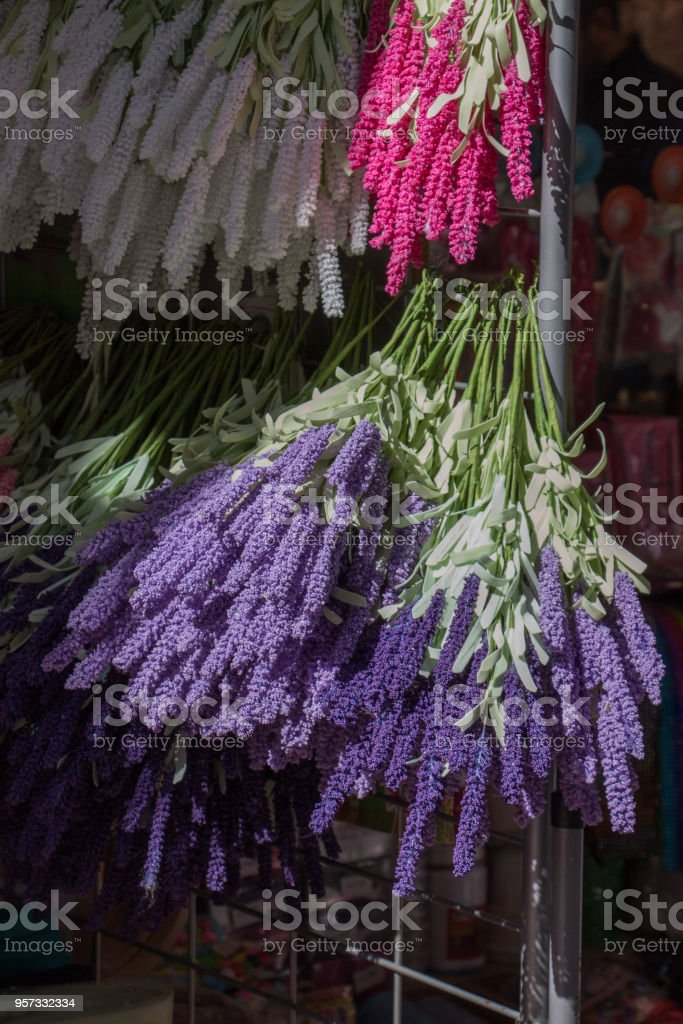 Fake artificial flowers  in view stock photo