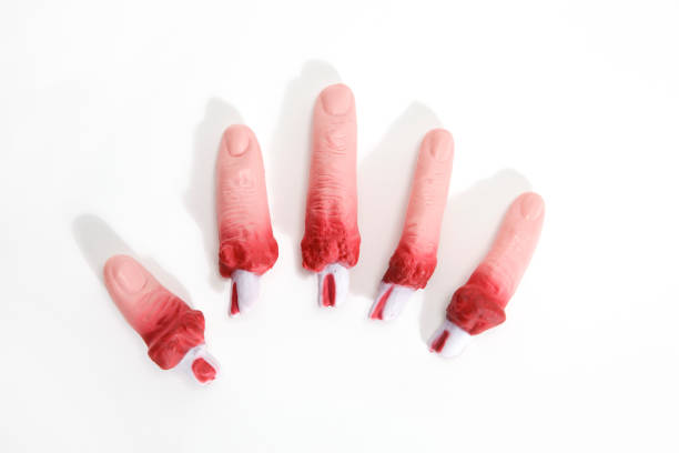 fake bloodied plastic fingers stock photo