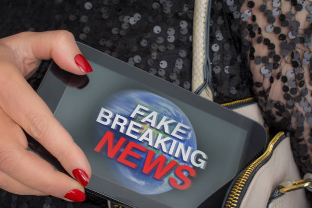 Fake breaking news on tablet in her handbag stock photo