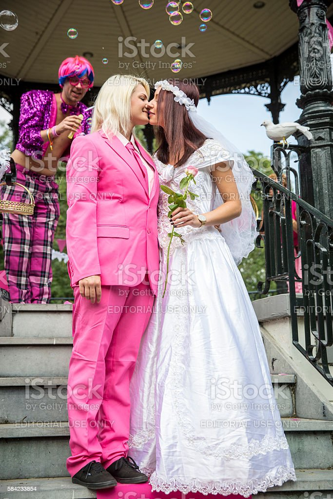 Fake burlesque weddings Pink Saturday Gay Euro Pride  Vondelpark  Amsterdam stock photo