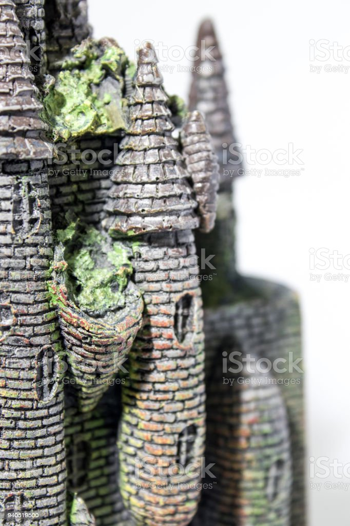 Fake castle with seaweed in a white backgorund composition stock photo