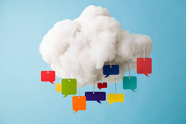 Fake cloud with colourful speech bubbles stock photo