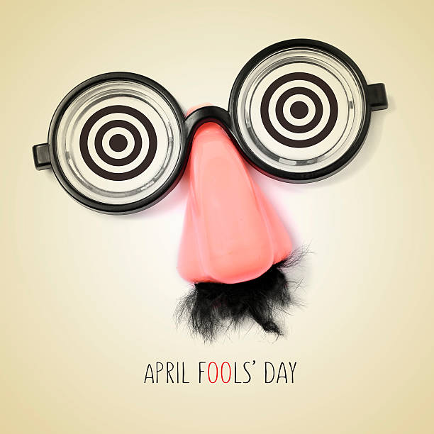 fake eyeglasses and text april fools day fake eyeglasses, nose and mustache and the sentence april fools day written in a beige background, with a retro effect april fools day stock pictures, royalty-free photos & images