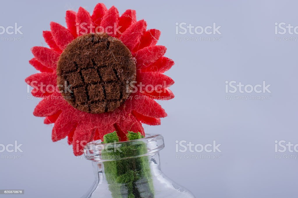 Fake flower in a bottle in view zbiór zdjęć royalty-free