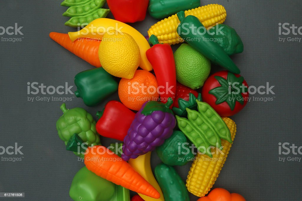 Fake Fruits and Vegetables on a Chalkboard Surface stock photo