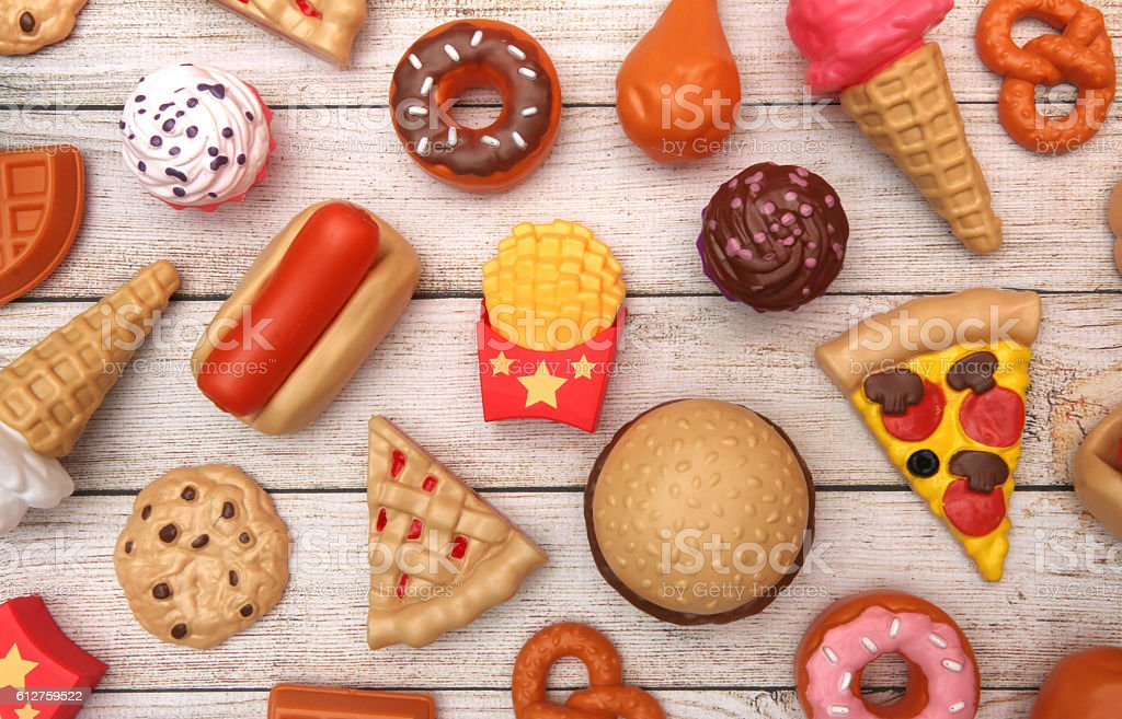 Fake Junk Food on a Wooden Table stock photo